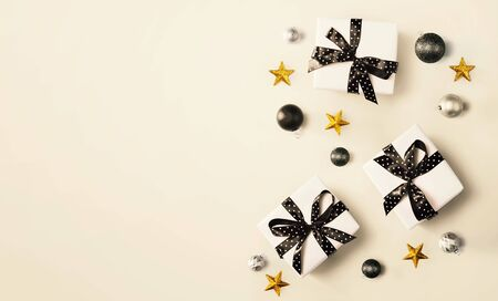 Christmas gift box with baubles - overhead view flat lay