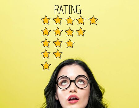 Rating theme with young woman wearing eye glasses Reklamní fotografie
