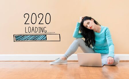 Loading new year 2020 with young woman using a laptop computer Standard-Bild - 133756233