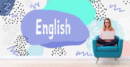English with young woman using her laptop in a chair