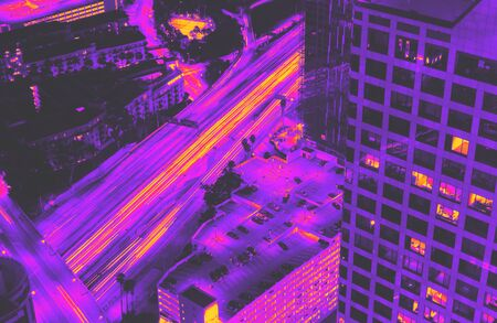 Aerial view of the expressway going through Downtown Los Angeles, CA synth wave style