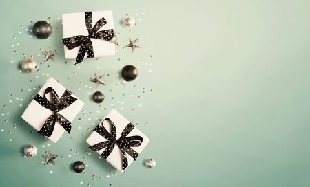 Christmas gift box with baubles - overhead view flat lay Stock Photo - 134082285