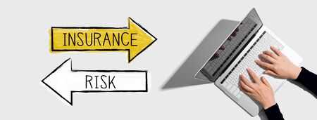 Insurance or risk with person using a laptop computer