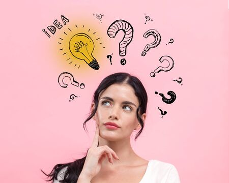 Idea light bulbs and question marks with young woman in thoughtful pose