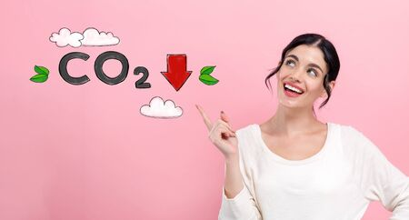 Reduce CO2 concept with happy young woman