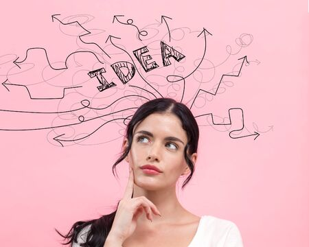 Brainstorming idea arrows with young woman in thoughtful pose