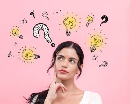 Question with light bulbs with young woman in thoughtful pose Stock Photo