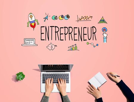 Entrepreneur with people working together with laptop and notebook