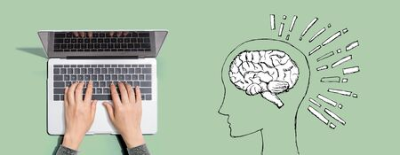 Brain illustration with person using a laptop computer