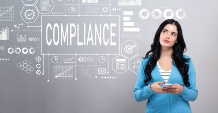 Compliance concept with thoughtful young woman holding a smartphone Stock fotó