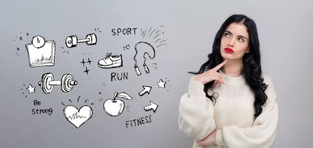 Fitness and diet with young woman in a thoughtful face
