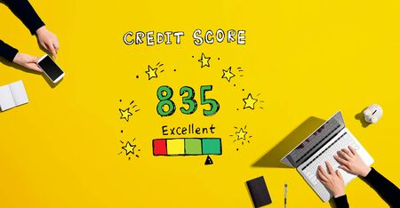 Excellent credit score theme with people working together with laptop and phone