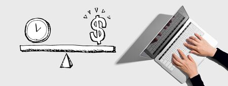 Time and money on the scale with person using a laptop computer