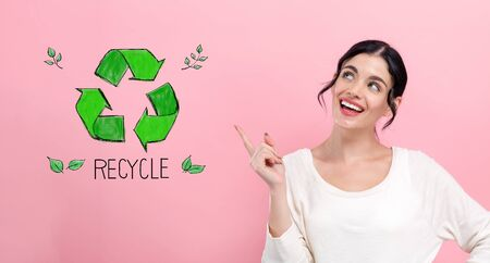Recycle concept with happy young woman pointing