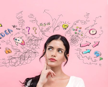 Many thoughts with young woman in thoughtful pose Stock Photo