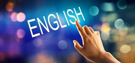 English concept with hand pressing a button on a technology screen Stock Photo