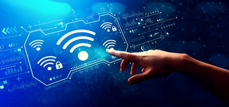 Wifi with hand pressing a button on a technology screen