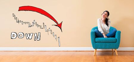Market down trend chart with woman in a thoughtful pose in a chair Фото со стока