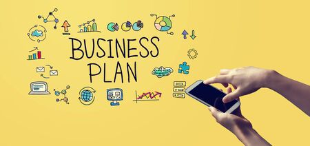 Business plan with person holding a white smartphone