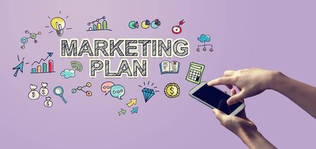 Marketing plan with person holding a white smartphone Stock fotó