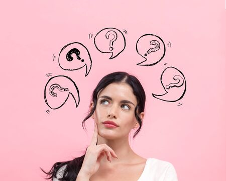 Question marks with speech bubbles with young woman in thoughtful pose