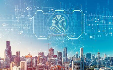 Fingerprint scanning theme with downtown Chicago cityscape skyscrapers