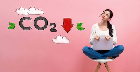 Reduce CO2 with young woman using a laptop computer