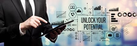 Unlock your potential with businessman using his tablet computer