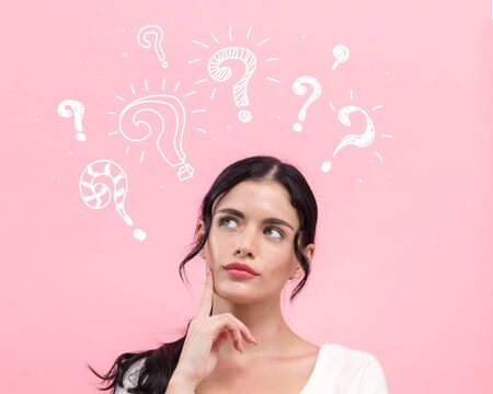Question marks with young woman in thoughtful pose