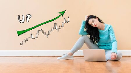 Market up trend chart with young woman using a laptop computer