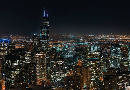 Chicago cityscape skyscrapers at night aerial view