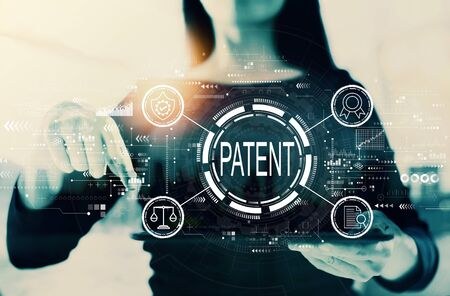 Patent concept with businesswoman on a city background