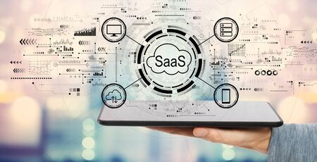 SaaS - software as a service concept with man holding a tablet computer Stock Photo