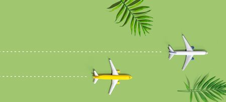 Flights booking and reservation theme with two miniature airplanes Banco de Imagens