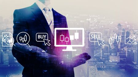 Stock trading theme with businessman on a city background