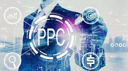 PPC - Pay per click concept with businessman on a city background Stock Photo