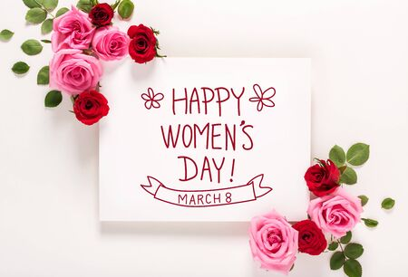 Womens Day message with roses and leaves top view flat lay Foto de archivo