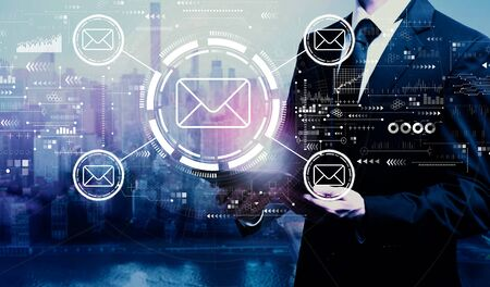 Email concept with businessman holding a tablet computer