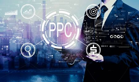 PPC - Pay per click concept with businessman holding a tablet computer
