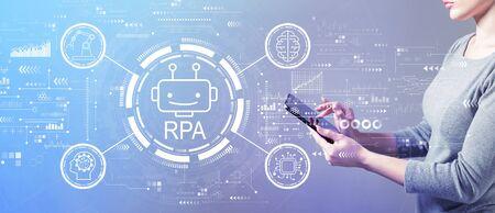 Robotic process automation concept with business woman using a tablet computer Banco de Imagens