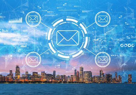 Email concept with downtown Chicago cityscape skyline with Lake Michigan