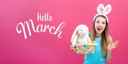 Hello March message with young woman with Easter basket