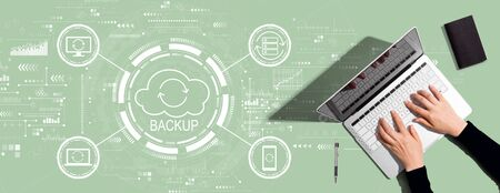 Backup concept with person using a laptop computer Banque d'images