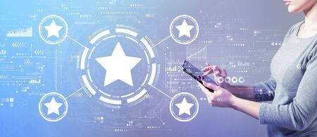 Rating star concept with business woman using a tablet computer