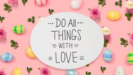 Do all things with love message with Easter eggs on a pink background