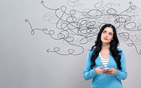Solving a problem concept with thoughtful young woman holding a smartphone