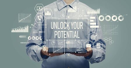 Unlock your potential with young man holding a tablet computer