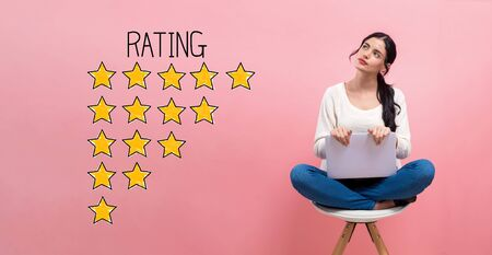 Rating theme with young woman using a laptop computer