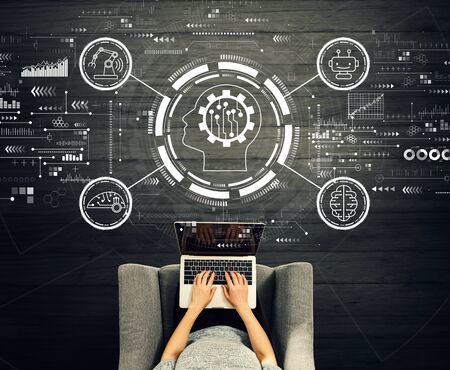 Future technology concept with person using a laptop in a chair Banco de Imagens