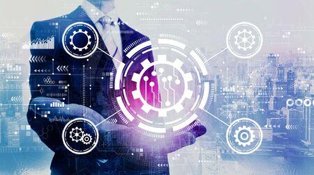 Automation concept with businessman on a city background Banco de Imagens
